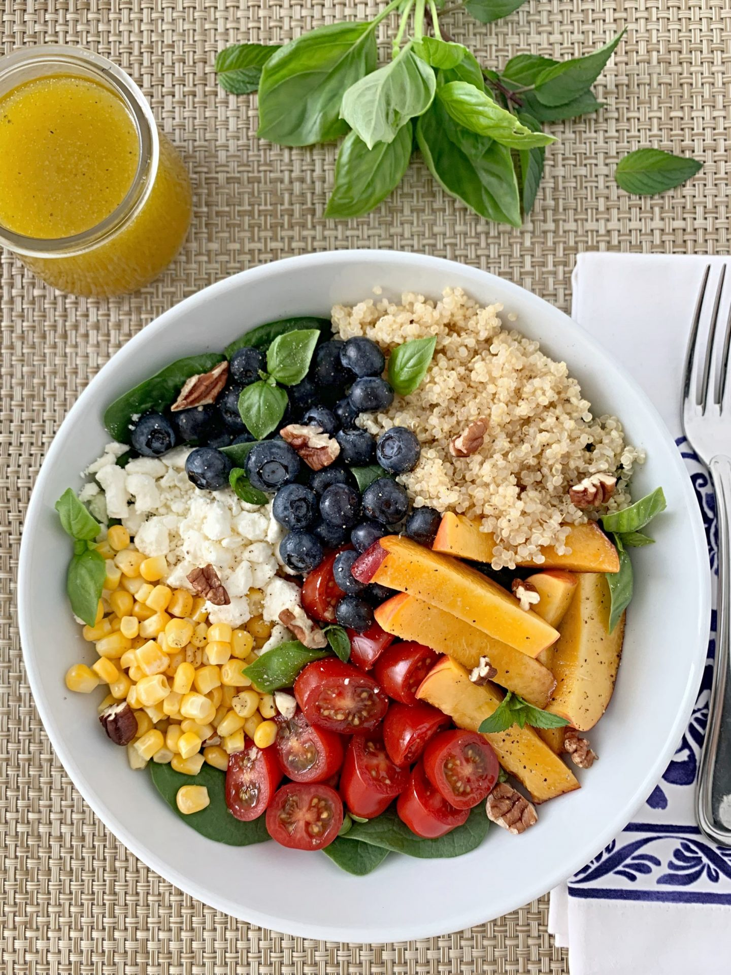 Perfect summer produce, hearty quinoa, and a white balsamic vinaigrette make the best summer salad.
